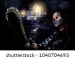 Horror Clown With Chainsaw Nea...