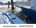 boat at the winter berth | Shutterstock . vector #1040705536