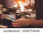 female employee in a store with ... | Shutterstock . vector #1040714446