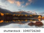 Small photo of fantastic foggy landscape at Germanian Alps. Colrful Clouds on Blue Sky over the Zugspitze mountains at early morning in autumn, Bavaria, Germany. Fresh grass on foreground. Awesome nature background