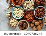 mixed nuts on grey background.... | Shutterstock . vector #1040736244
