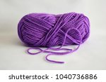 Ball Of Purple Yarn On White...