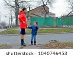 mom and his son on the... | Shutterstock . vector #1040746453
