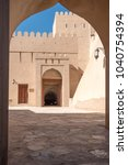 Small photo of Nizwa Fort, Oman - February 7th 2018: Nizwa Fort is one of the most popular tourist attractions in Oman due to the fact that it is an amazing example of old Omani architecture.