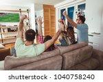 happy friends or football fans... | Shutterstock . vector #1040758240