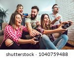 group of friends play video... | Shutterstock . vector #1040759488