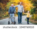elderly father adult son and... | Shutterstock . vector #1040760010