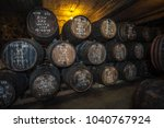 port wine barrels in cellar ... | Shutterstock . vector #1040767924