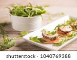 canapes with smoked salmon and... | Shutterstock . vector #1040769388