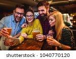 friends at the bar drinking... | Shutterstock . vector #1040770120