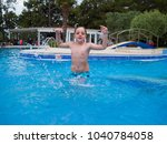little boy having fun playing... | Shutterstock . vector #1040784058