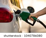 white car at gas station being... | Shutterstock . vector #1040786080