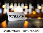 reserved plate on night club ... | Shutterstock . vector #1040786320