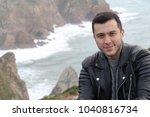 handsome ethnic man with winter ... | Shutterstock . vector #1040816734