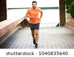 young athlete man is jogging in ... | Shutterstock . vector #1040835640