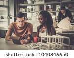 multiracial couple working in... | Shutterstock . vector #1040846650