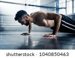 man boxer training hard for a... | Shutterstock . vector #1040850463
