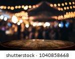 empty wooden table in front of... | Shutterstock . vector #1040858668