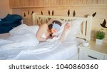 young woman with sleeping mask... | Shutterstock . vector #1040860360