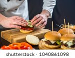 cooking burger in the kitchen | Shutterstock . vector #1040861098
