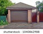 Brown Gate In A Private Garage...