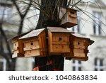 bird houses in an autumnal tree | Shutterstock . vector #1040863834