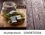 Stock photo herring sandwich traditional danish smorrebrod on cutting board copyspace 1040870206