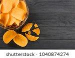 heap of potato chips in wicker... | Shutterstock . vector #1040874274