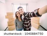 happy attractive young couple... | Shutterstock . vector #1040884750