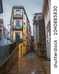 colorful city street in porto ... | Shutterstock . vector #1040885830