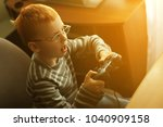 red haired boy with glasses... | Shutterstock . vector #1040909158