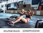 two attractive sporty women are ... | Shutterstock . vector #1040910244