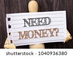 Small photo of Word, writing, text Need Money Question. Conceptual photo Economic Finance Crisis, Cash Loan Needed written torn paper holding by sculpturethe wooden background