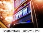 Small photo of Luxury Casino Slot Machine Awaiting New Player. One Handed Bandit Fruit Machine.