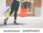happy woman with shopping bags... | Shutterstock . vector #1040944693