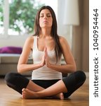 young woman practicing yoga in... | Shutterstock . vector #1040954464