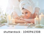 girl lying down on a massage bed | Shutterstock . vector #1040961508