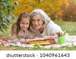 girl with her grandmother... | Shutterstock . vector #1040961643