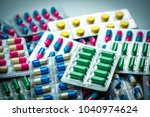 pile of colorful tablets and...   Shutterstock . vector #1040974624