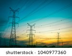 sun setting behind the... | Shutterstock . vector #1040977360