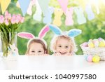 family easter morning. children ... | Shutterstock . vector #1040997580
