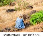 little girl standing on rock | Shutterstock . vector #1041045778