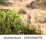 little girl standing on rock | Shutterstock . vector #1041046078