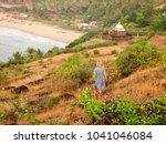 little girl standing on rock | Shutterstock . vector #1041046084