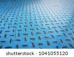a blue iron floor with regular...   Shutterstock . vector #1041055120