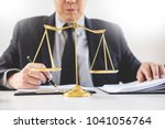 lawyer judge reading and writes ... | Shutterstock . vector #1041056764