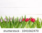 bouquet of tulips on a table... | Shutterstock . vector #1041062470