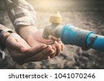female hands want to drink some ... | Shutterstock . vector #1041070246