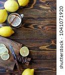 tea with lemons in a rustic... | Shutterstock . vector #1041071920