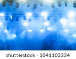 stage lights during a rock... | Shutterstock . vector #1041102334